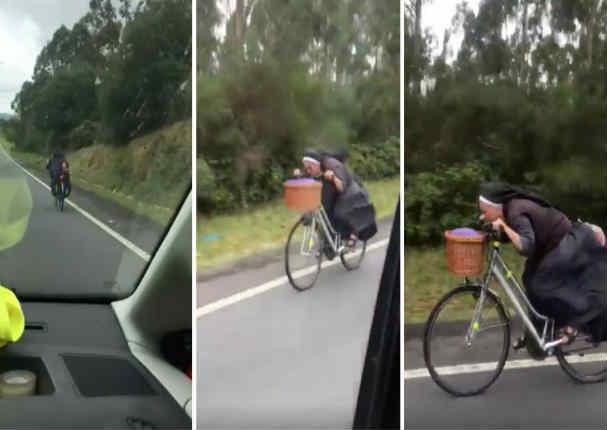 ¡Impresionante! Conductor graba a monja en bicicleta en plena carretera