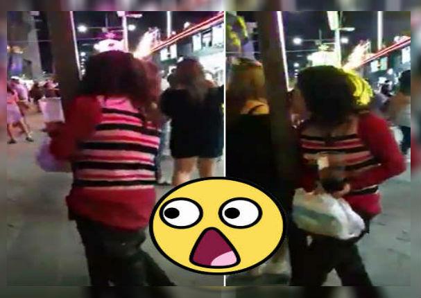 Mujer en estado de ebriedad agarra a besos a un poste de luz creyendo que era su pareja